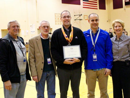 Cherokee Middle School Principal Bill Powers, middle, with, from left, school board members Bruce Renner and Charles Taylor, and administrators Shane Dublin and Sheila Wynn.