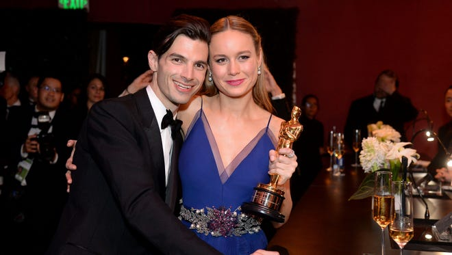 Please enjoy this throwback photo of Brie Larson (with fiance Alex Greenwald ) posing with her 'Room' best-actress Oscar in 2016.