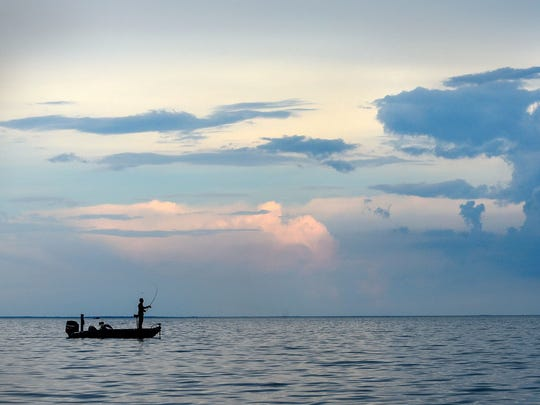 An angler fishes on Mille Lacs Lake.