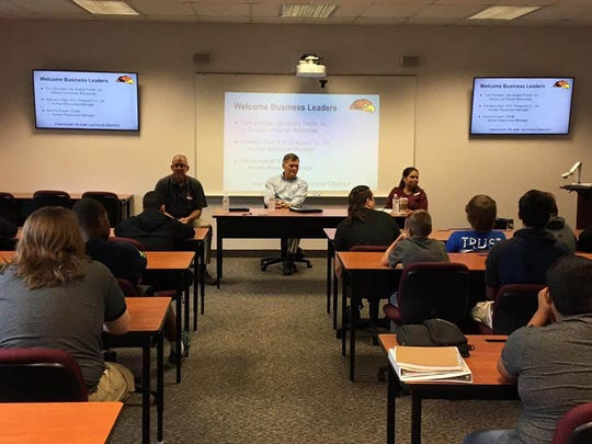 Representatives from Utz Quality Foods, ESAB and RH Sheppard speak with students at Hanover High School during a manufacturing panel discussion.
