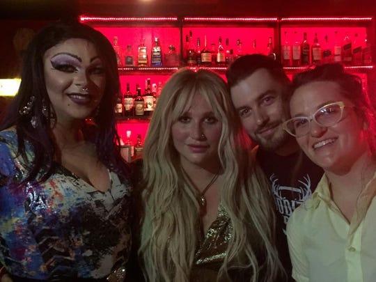 "Pop singer Kesha (second from left) with Oddity Bar staff Ron Killen, Christopher ""Devo"" Devitt and Melissa Colegrove."