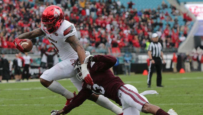 Louisville's Jaylen Smith scores against Mississippi State late in the first half of the TaxSlayer Bowl. Dec. 30, 2017.