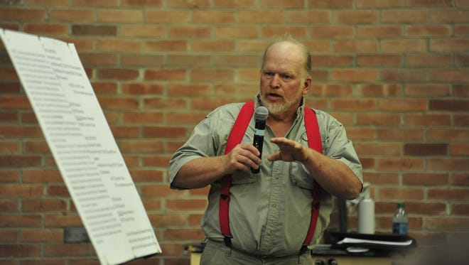 Brett Heffner of the Black Fork Clean-Up Project talks to a crowd of nearly 200 Thursday night.