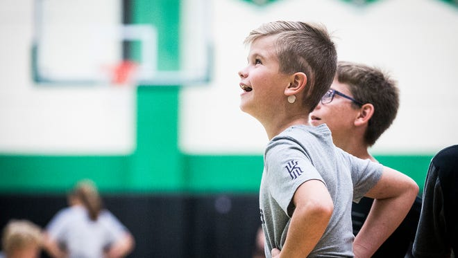 Tyler Aul joins dozens of other young athletes at a Yorktown basketball camp.