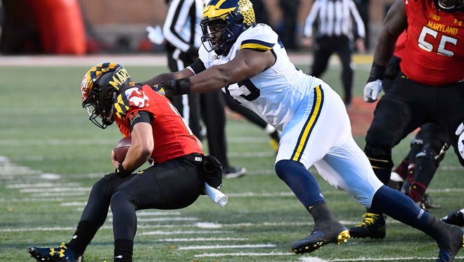 Michigan defensive lineman Maurice Hurst (73) tackles Maryland quarterback Ryan Brand (16) for a loss during the first half on Saturday, Nov. 11, 2017, in College Park, Md.