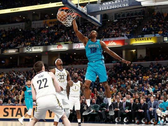 Charlotte Hornets center Dwight Howard (12) dunks against