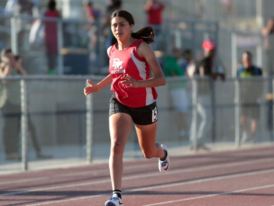 Desert Mirage's Fabiana Zavala crosses the finish line first to win the DeAnza League title in the Girls 400m dash on Thursday, May 3, 2018 in Desert Hot Springs.
