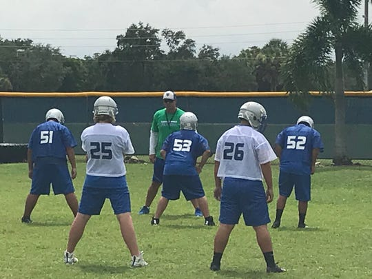 Bonita Springs football coach Rich Dombroski instructs