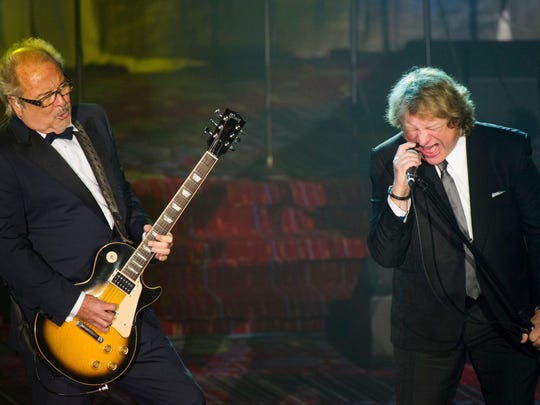 Gates native and Foreigner's original lead singer, Lou Gramm, pictured here with Mick Jones during the 2013 Songwriters Hall of Fame induction, sang three songs on stage during encores with Foreigner on Thursday night.