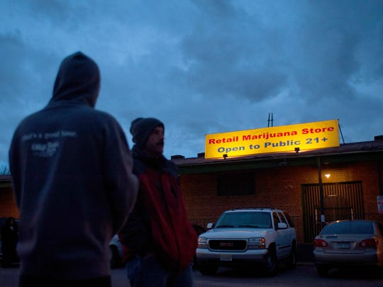 DENVER, CO - JANUARY 1: A sign is displayed outside the 3-D Denver Discrete Dispensary on January 1, 2014 in Denver, Colorado. Legalization of recreational marijuana sales in the state went into effect at 8am this morning. (Photo by Theo Stroomer/Getty Images)