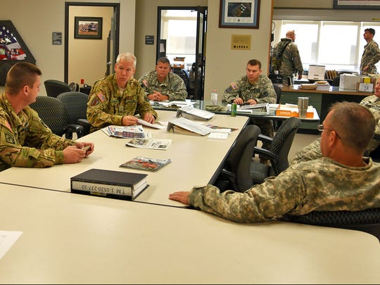Louisiana National Guard pilots and crew chiefs from Army Aviation Support Facility #2 at Esler Field in Pineville, Louisiana, conduct a mission brief prior to departing for South Carolina, Oct. 8, 2016.
