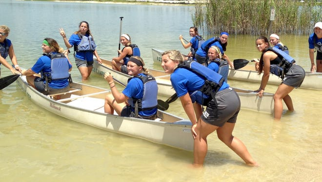 The FGCU softball team combines customary fitness tests in the 1.5-mile run, 20-yard sprint and other events with team-bonding games in beach volleyball, tug-o-war, canoe races and more for the 2016 edition.