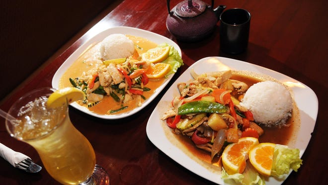 """At left, Red curry with chicken and chicken with cashew nuts prepared by Supakit """"Ray"""" Chaijirawat, owner of Thai Hana, a Thai restaurant and sushi bar at the Avenue Viera, next to Kohl's department store."""