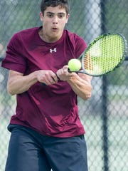 Henderson County junior Jon Nunez returns the ball back to Caldwell County's Ben Knight in the Second Region boys singles final at the Doc Hosbach Tennis Complex in Henderson, Ky., Wednesday, May 9, 2018. Nunez lost to Knight 6-2, 7-5.