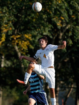 Brian Coscarelli, right, and Haslett will face East Lansing in the CAAC Gold Cup final Tuesday at Mason.