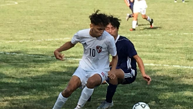 Emporia senior Hector Hernandez (10), who had two goals on the day, battles Hayden sophomore Chris Hayes for the ball Tuesday in Emporia's 4-1 victory.