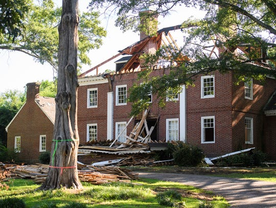 Demolition continues at a home on the corner of Augusta
