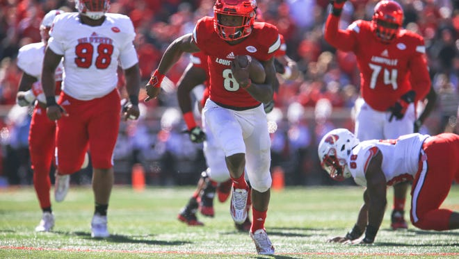 Lamar Jackon scored Louisville's first touchdown early in the first half as the Cardinals rolled to 44-0 halftime lead over NC State Saturday, Oct. 22.