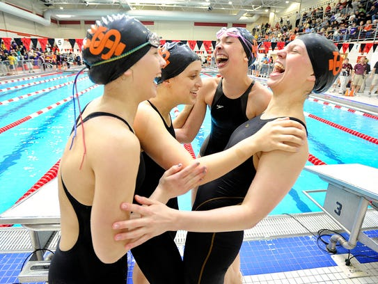 York Suburban's Anna Schmittle, left, celebrates after