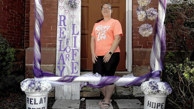 Amanda Rogers, Relay For Life Canal Winchester-Groveport co-chairwoman, is shown with the Relay For Life photo booth set up outside Faith United Methodist Church on June 19. The COVID-19 coronavirus pandemic forced Relay For Life to host a virtual event and as part of that event, guests can come take photo at the booth and share the pictures online. The main virtual event is Satuday, June 27.