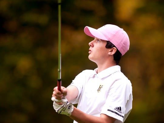 Harwood's Aidan Melville watches his tee shot on the 17th hole during the Vermont high school boys golf state championships on Wednesday at Green Mountain National Golf Course in Killington.