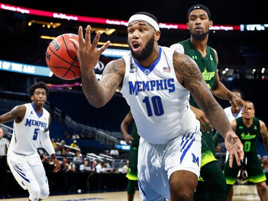 Memphis forward Mike Parks Jr., (front) loose the ball to of bounds while taken on USF during second half action of their AAC first round tournament game in Orlando, Fl., Thursday, March 8, 2018.