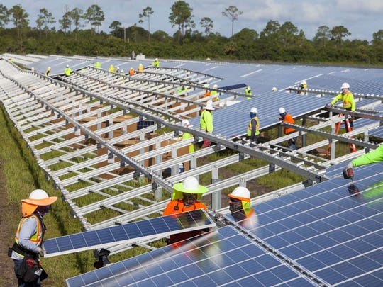 Solar panels being installed in 2016 at the Florida Power & Light Babcock Ranch Solar Energy Center in Charlotte County. The panels are the same size as the panels FPL plans to install on the Treasure Coast.