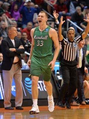 Marshall Thundering Herd guard Jon Elmore (33) reacts after scoring a basket against the Wichita State Shockers during the second half in the first round of the 2018 NCAA Tournament at Viejas Arena.