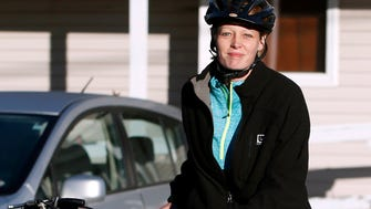 Nurse Kaci Hickox leaves her home on a rural road in Fort Kent, Maine, to take a bike ride with her boyfriend Ted Wilbur, on Oct. 30, 2014.