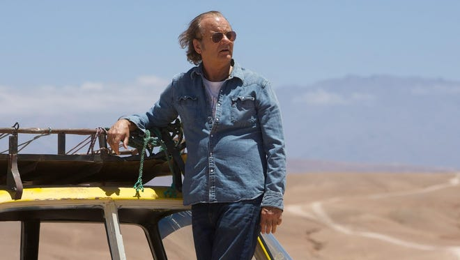 """Bill Murray plays Richie Lanz, a down-on-his-luck rock manager who takes his latest would-be act (Zooey Deschanel) on a USO tour of Afghanistan in """"Rock the Kasbah."""""""