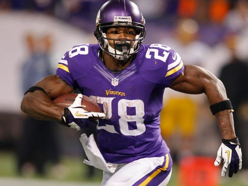 Nov 7, 2013; Minneapolis, MN, USA; Minnesota Vikings running back Adrian Peterson (28) runs for a touchdown against the Washington Redskins in the third quarter at Mall of America Field at H.H.H. Metrodome. The Vikings win 34-27. Mandatory Credit: Br