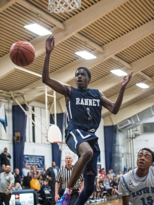 Bryan Antoine (1) of Ranney School watches a loose ball go out of bounds. At right is Mater Dei's Kenneth Jones (15). Ranney School traveled to Mater Dei Prep for boys basketball in Middletown, NJ, on Thursday, February 4, 2016. /Russ DeSantis for the Asbury Park Press / Slug:ASB 0205 boys basketball roundup