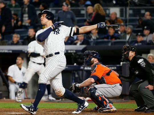 Yankees' Aaron Judge hits a home run during the seventh inning of Game 4 of the ALCS.