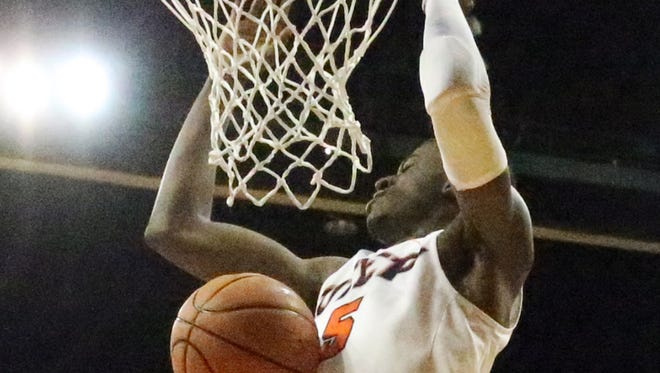 UTEP's Trey Wade, 5, gets his turn slamming the ball into the rim against Rice Saturday night.