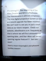 "A sign at the Allen Theatre and MJ's Coffee House on Wednesday announces that it will reopen just in time for the release of the latest in the ""Star Wars"" franchise, ""Star Wars: The Force Awakens."""