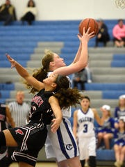 Falcon center Alyssa Austin (43) goes up for two of her 19 points to go with 20 rebounds.