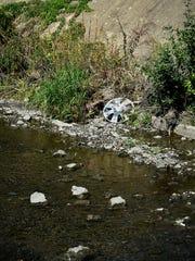 A hub cap rests on the bank of the Quittapahilla Creek