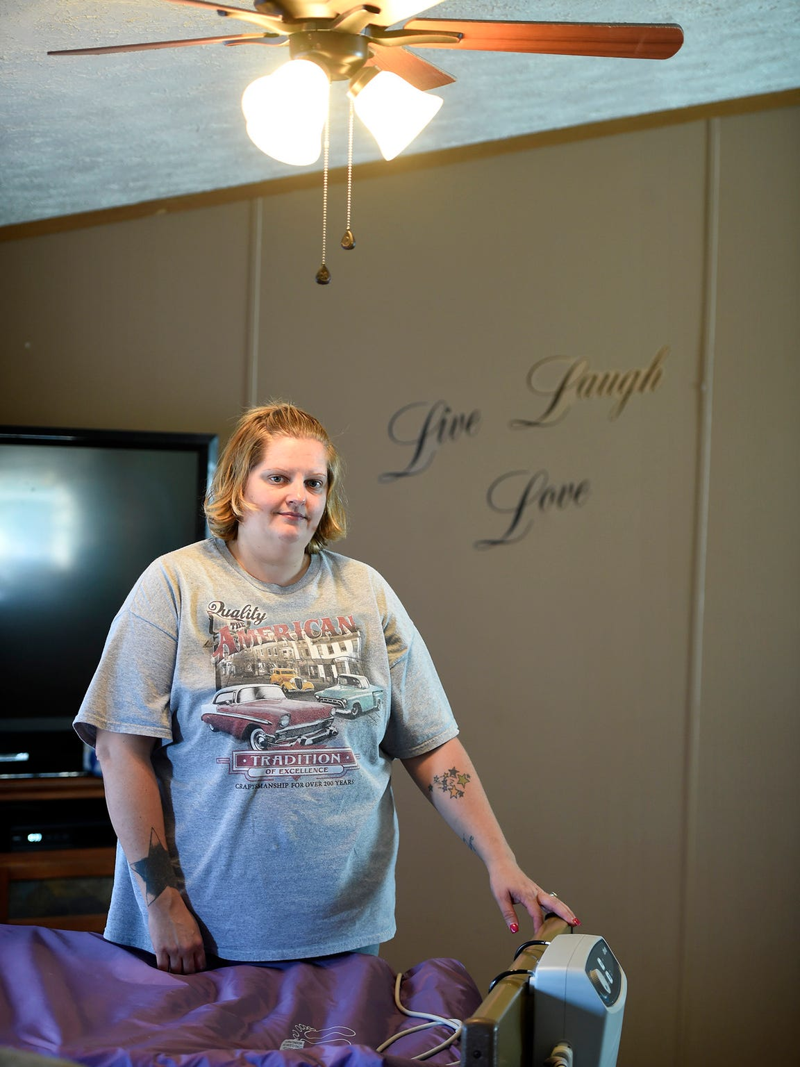 Christina Grenier poses for a picture Oct. 17 inside a North Lebanon Township home belonging to her mother, Kathleen Grenier. Grenier did not appreciate the care her mother received at The Gardens of Campbelltown, formerly Twin Oaks Nursing Home.