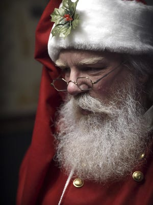 ADVANCE FOR SATURDAY, DEC. 3, AND THEREAFTER - In this Nov. 23, 2016 photo, John Gable, dressed as Santa Claus, poses for a portrait in his home in Lebanon, Pa. Gable, who works in customer service and took up his seasonal hobby of portraying Santa Claus in 2005, is such a stickler for detail that he bleaches his brown hair and beard, and learned leatherwork to craft his belt. (Michael K. Dakota/Lebanon Daily News via AP)