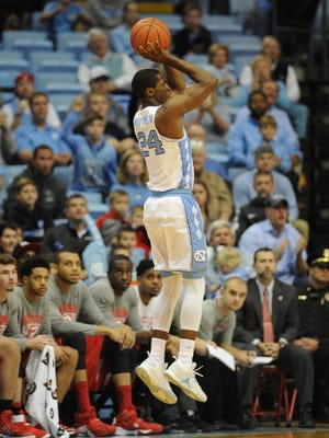 North Carolina Tar Heels guard Kenny Williams (24) shoots against the Radford Highlanders during the first half at Dean E. Smith Center.