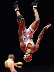 New Palestine's Chad Red celebrates with a backflip after defeating East Noble's Garrett Pepple during their 106-pound  match in the IHSAA Wrestling State Championship match Saturday evening at Bankers Life Fieldhouse.