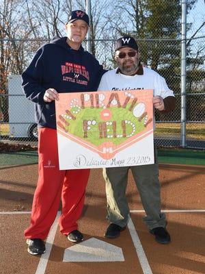 Peter McGowan, left, president of the Town of Wappinger Little League, stands with Mike Briccetti, right, vice president of the Challenger League, on Challenger Field at Robinson Lane Park in Wappingers Falls. They're holding a new sign for the field. The Town of Wappinger Little League is being honored as the recipient of the Richard K. Wager Inclusive Champion Award.