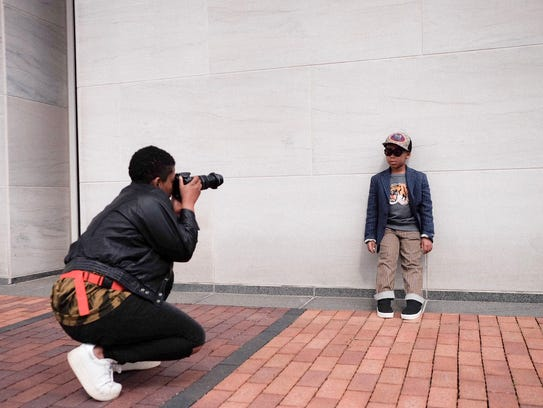 Keira Cannon takes a picture of her son, Princeton, for their Instagram account @princeandthebaker. He models an outfit from retailer Childrensalon, based in London.