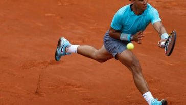 Rafael Nadal returns the ball to Dusan Lajovic during their fourth-round match at the French Open on Monday at the Roland Garros Stadium in Paris.