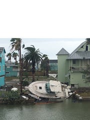 A boat is grounded after Hurricane Harvey at Ingleside-On-The-Bay.