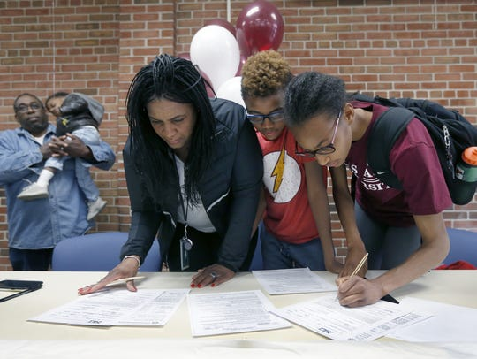 National high school record-holder Sammy Watson signs