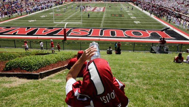 A fan watches UL's 2016 season-opener against Boise State from the lawn of Cajun Field, where new athletic department offices may or may not added.