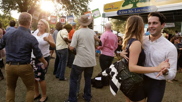Dancers enjoy Lil' Nathan and the Zydeco Big Timers on the opening day of Festivals Acadians at Creoles in Lafayette Oct. 14, 2016.