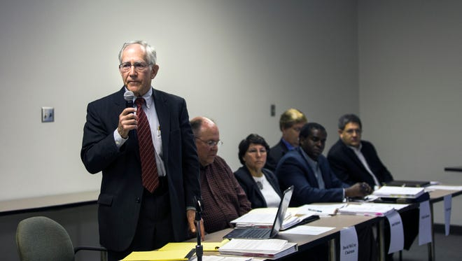 November 30, 2016 - Heading officer Bob McClain reminds the audience to silence their cell phones at the start of a hearing at the Office of Construction Code Enforcement on Wednesday. The hearing is being held by the Shelby County Groundwater Quality Control Board on the Sierra Club's appeal of two well permits for the TVA power plant in Southwest Memphis.