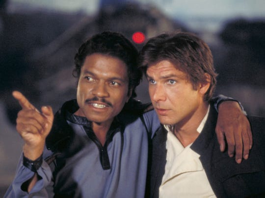 """Old pals Lando Calrissian (Billy Dee Williams) and Han Solo (Harrison Ford) reconnect in """"The Empire Strikes Back."""""""